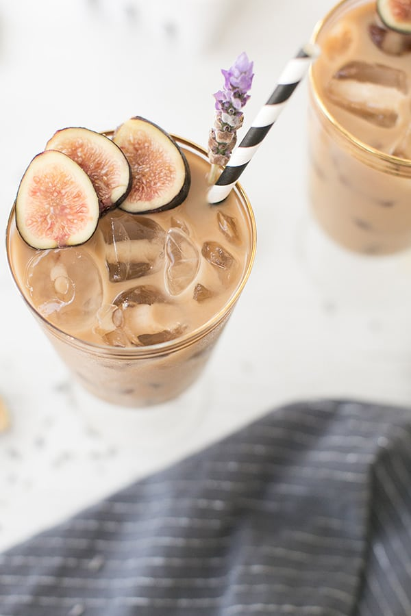 Finished drink in a glass with figs and lavender