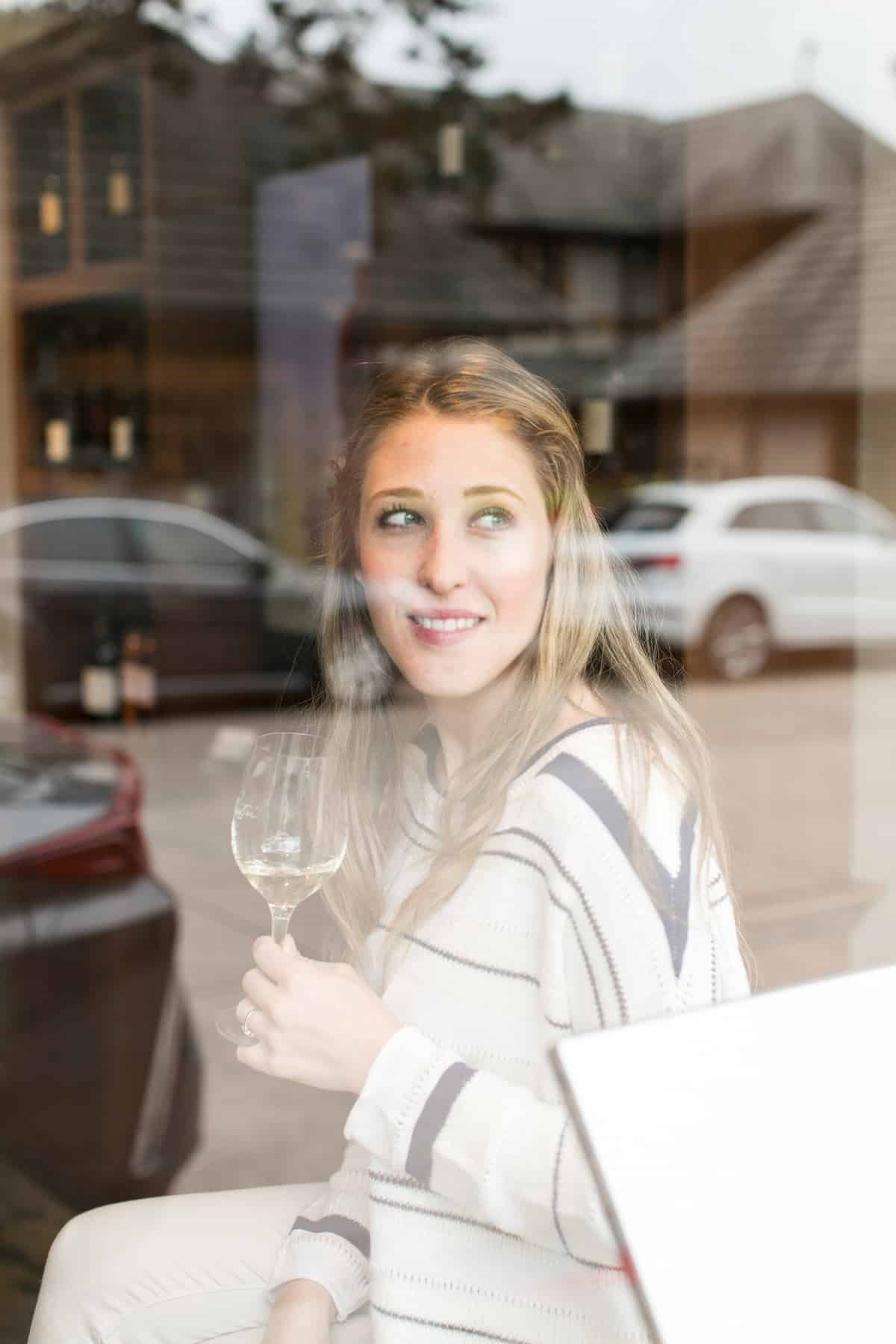 Eden Passante sitting in a tasting room in Carmel California
