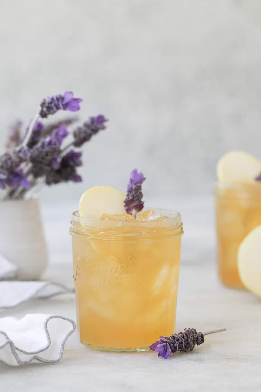 side shot of lavender apple vodka in a glass