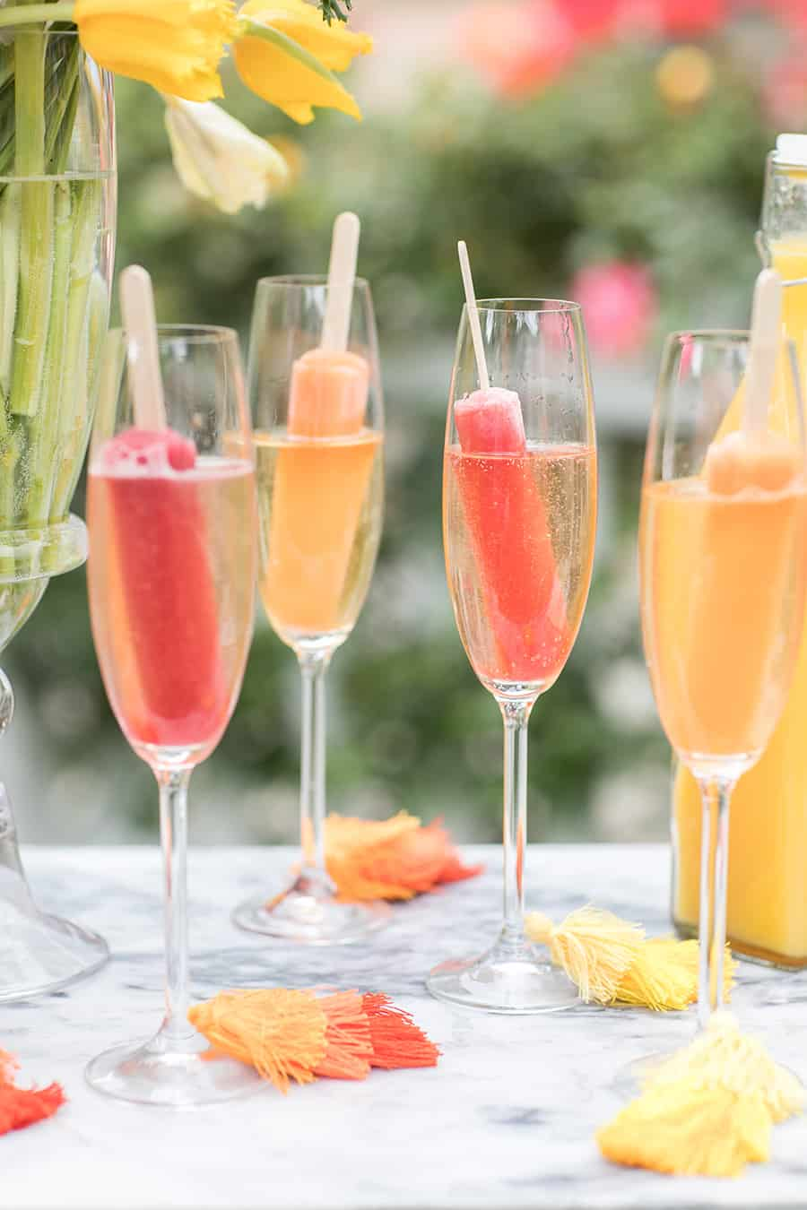 Popsicles in glasses filled with Champagne