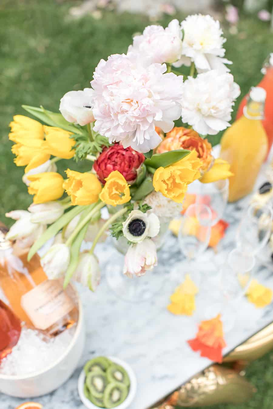 Beautiful flowers for a college graduation bubbly bar.
