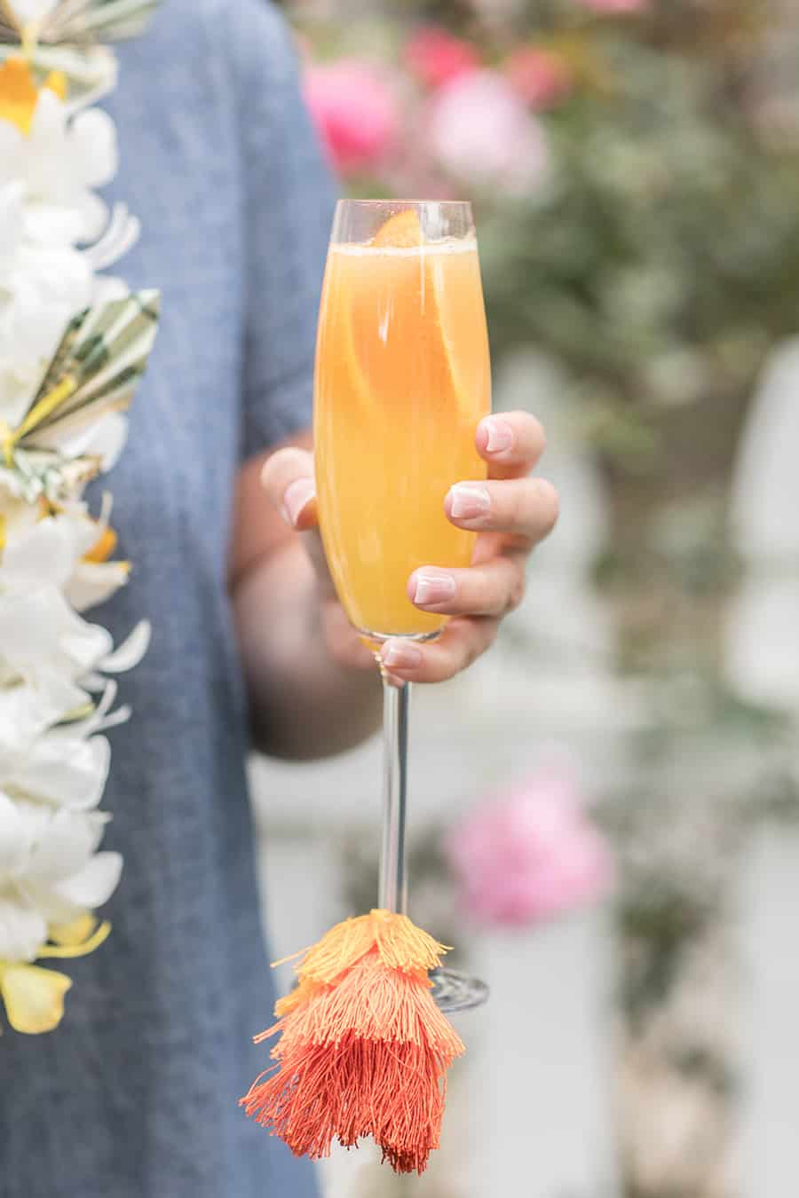 Holding a mimosa with a colorful tassel