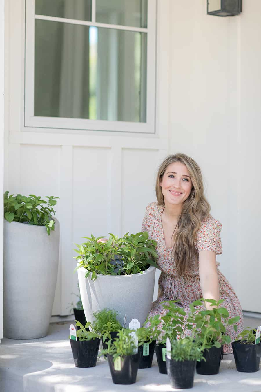 Eden Passante planting herbs on her side porch.