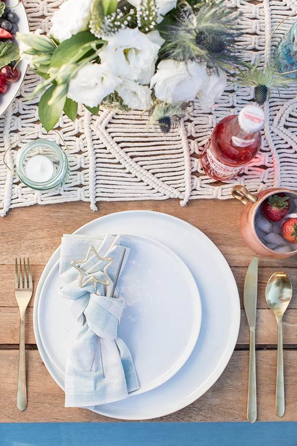 4th of July table setting with blue and white place settings.