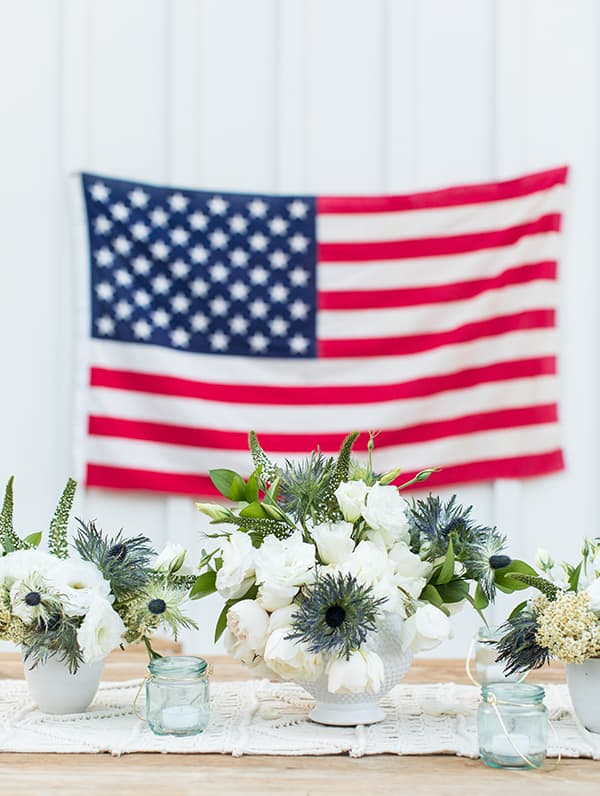 4th of July flowers in white vase.