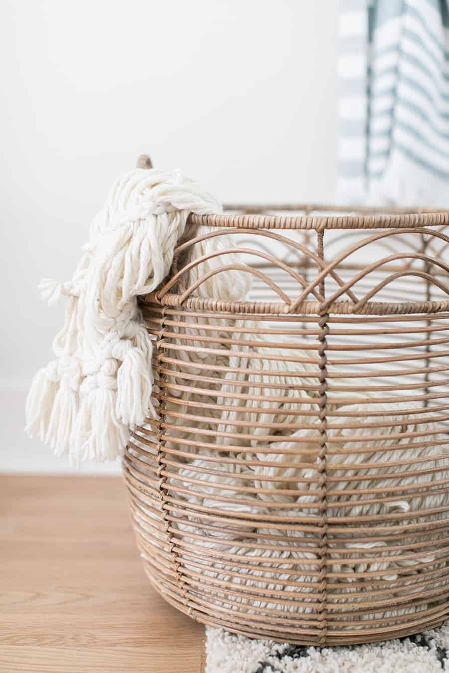 Laundry basket with a knit blanket