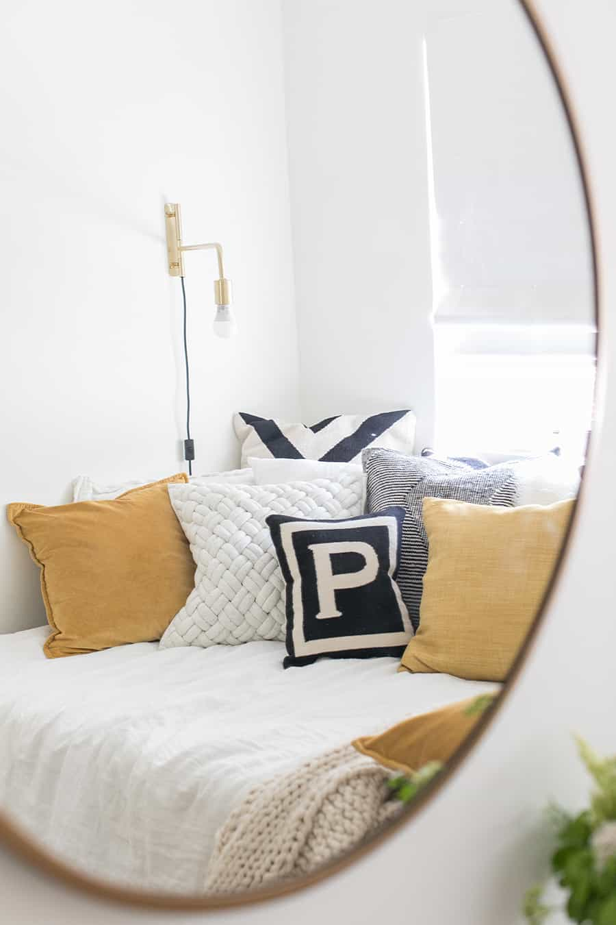 Photo in a mirror with pillows and gold light