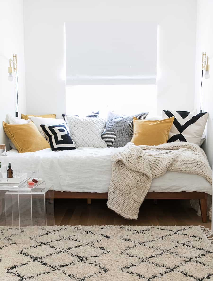 a picture of a bed with a lot of pillows.