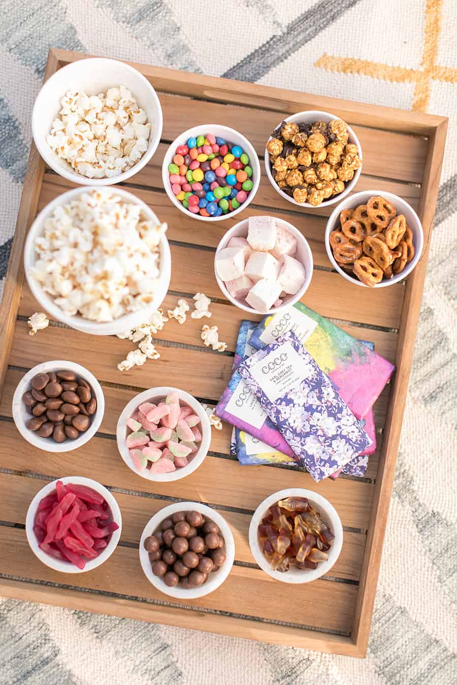 Overhead teak tray with bowls of candy.