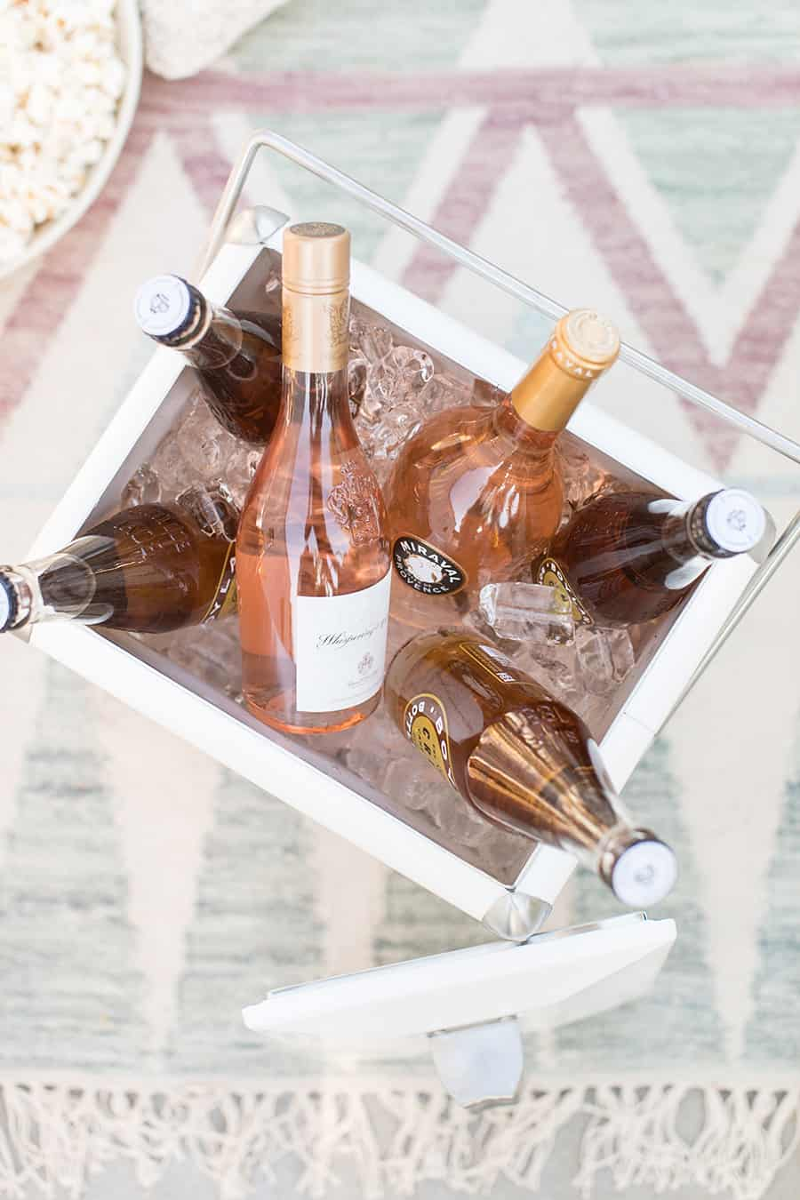 cooler filled with ice and bottles of rosé.