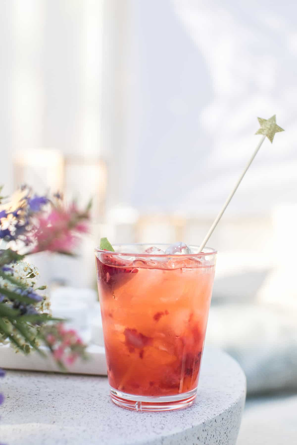 Strawberry soda with star stir stick.