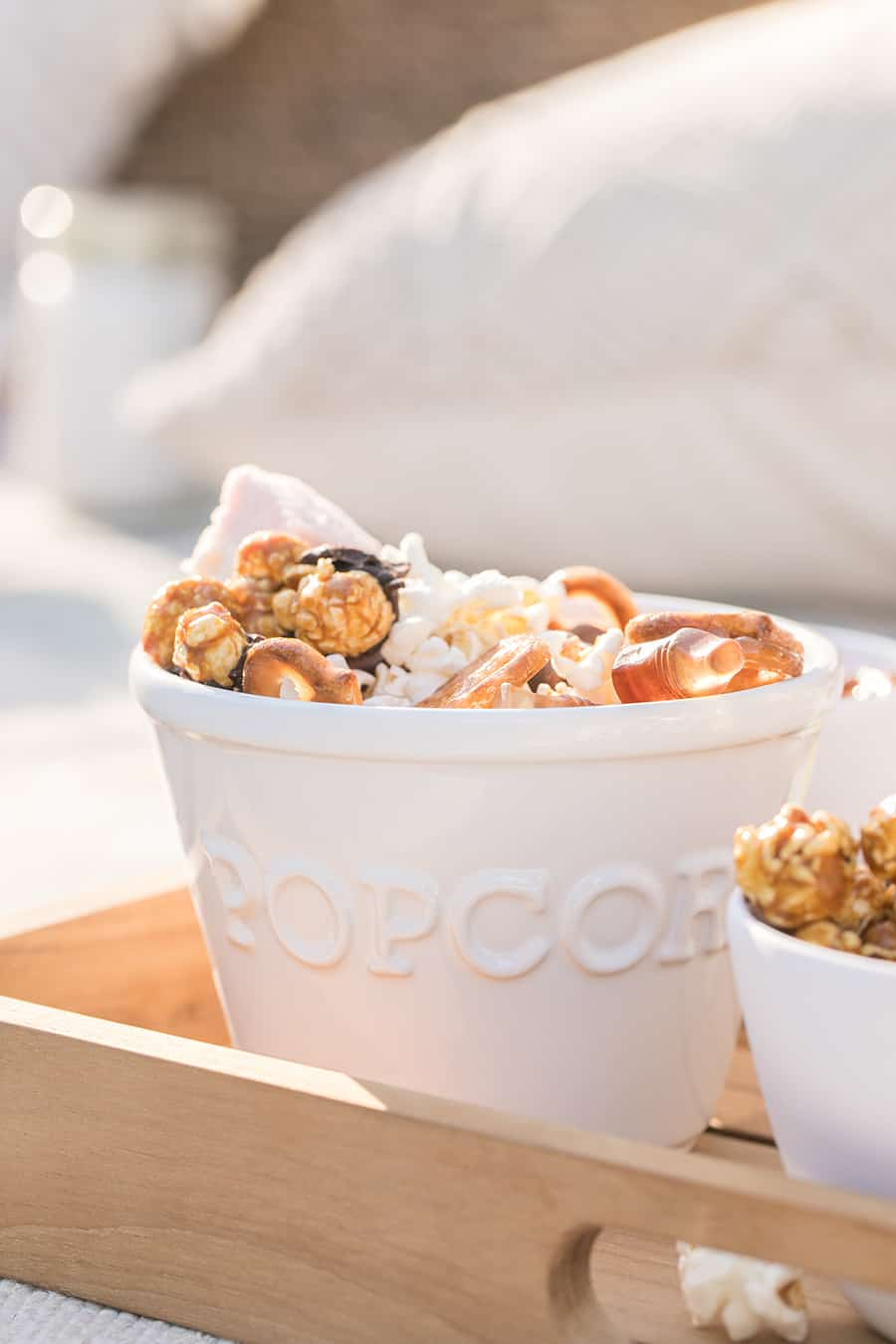 Popcorn bowl with popcorn with chocolate and pretzels.