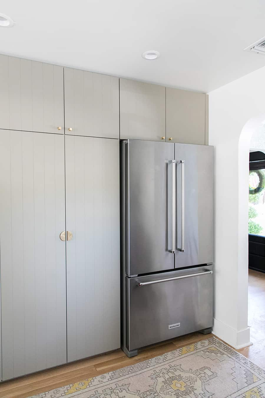 Kitchen Aid refrigerator with green cabinets from Ikea and Semihandmade.
