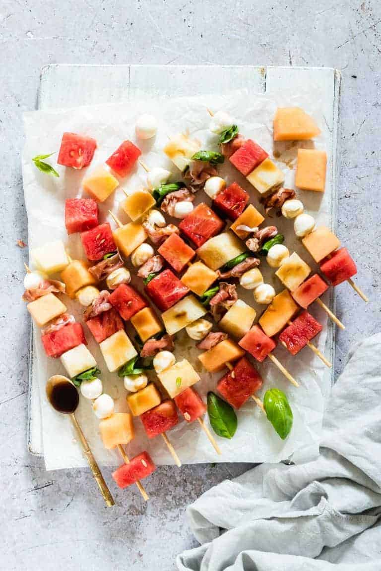 Skewers with watermelon, cheese and basil.