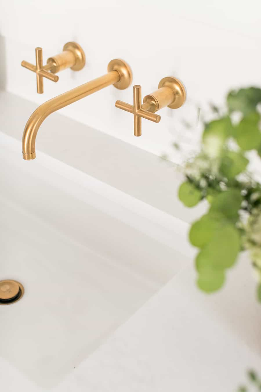 Gold Kohler facet in modern bathroom