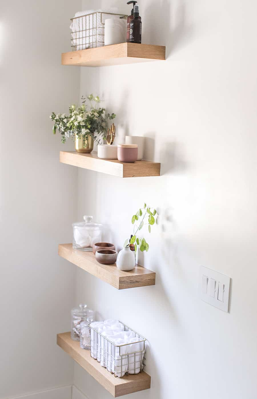Built in shelving units with decorations and towel.