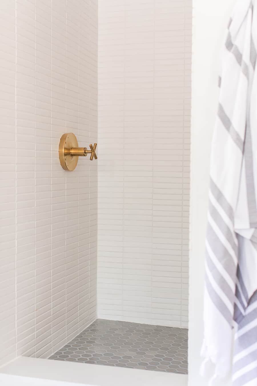 Fireclay shower tile with brass