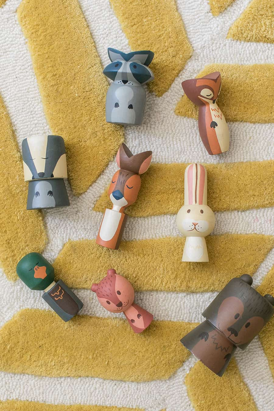 Wooden critters on a yellow rug