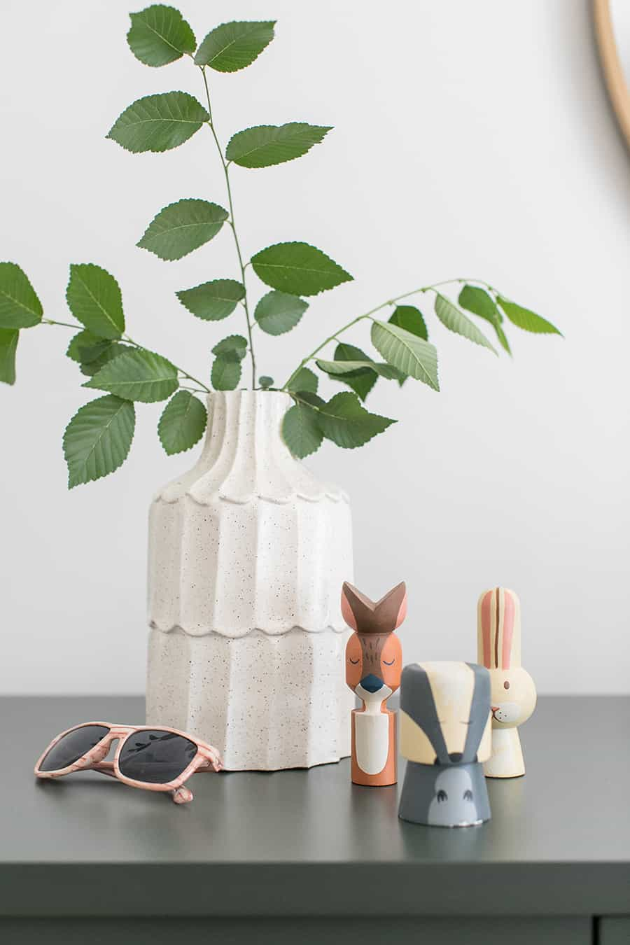 Ferns in a vase with wooden critters