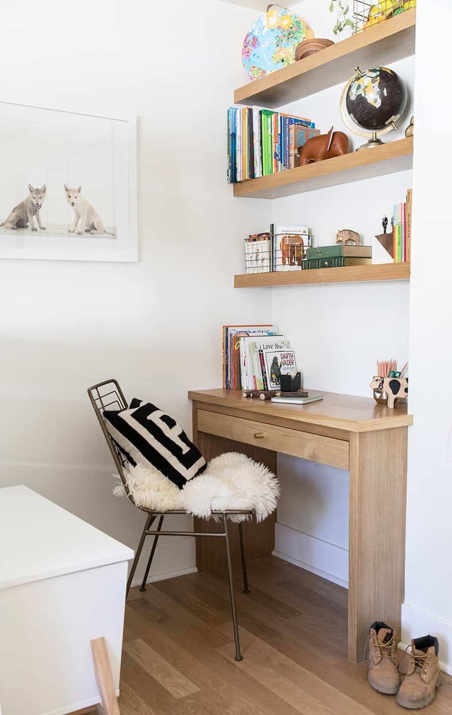 built in desk with shelves filled with books.