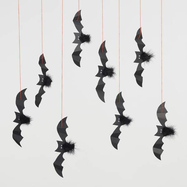 Paper bats hanging that are used for Halloween decorations.