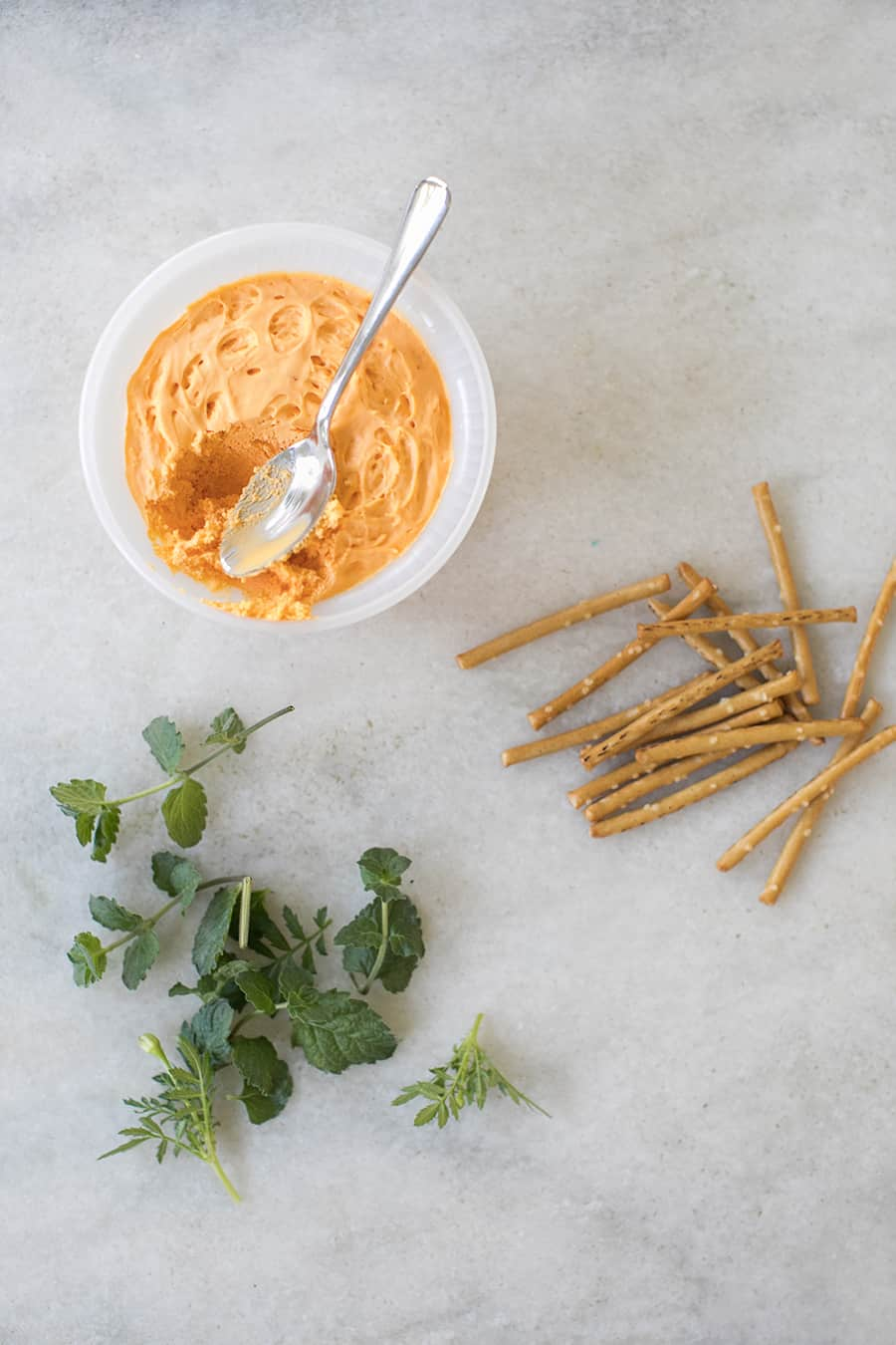 Pub cheese with pretzel sticks and herbs,