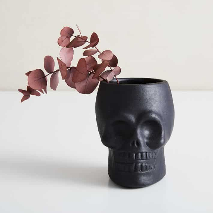 black skull vase to use for halloween decorations