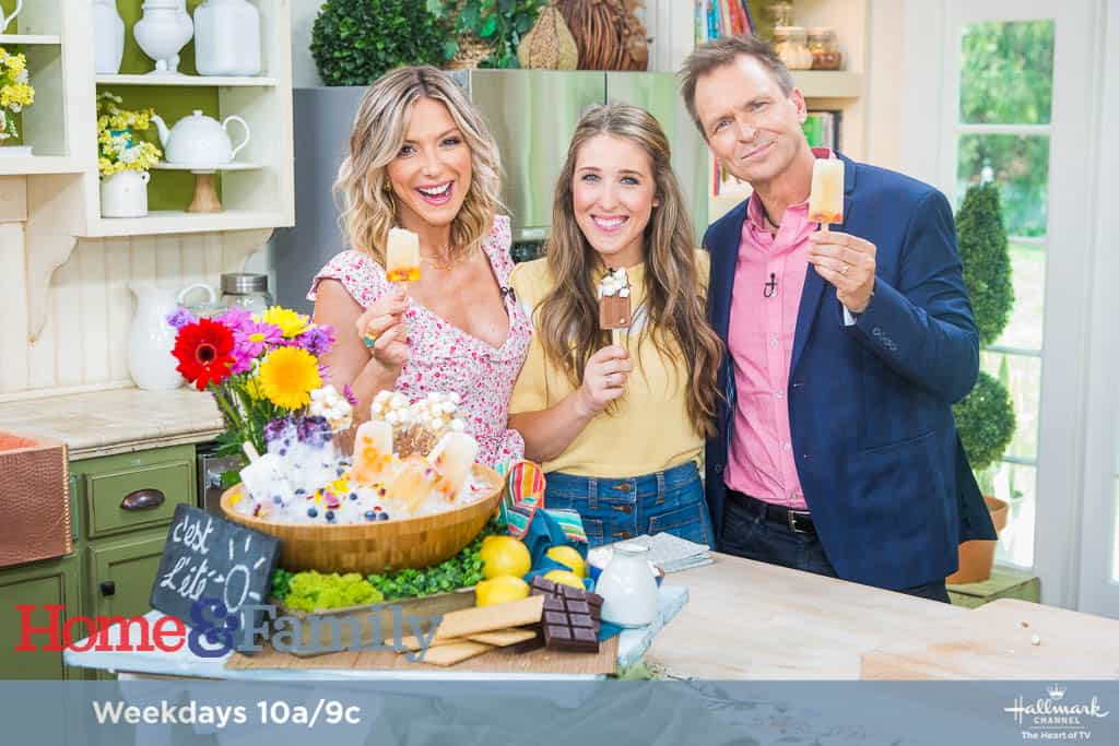 "Debbie Matenopoulos is joined by guest co-host Phil Keoghan from ""The Amazing Race."" VH1's ""Hit the Floor"" actress, Katherine Bailess prepares shrimp and cheesy grits. Entertaining expert Eden Passante makes gourmet summer popsicles. Lifestyle expert Theodore Leaf cooks spicy summer sausage and sauerkraut. ""Eat Cake. Be Brave."" author, internet sensation Melissa Radke visits our home. Debbie shows us her summer beauty must-haves. Orly Shani creates trendy summer sun hats. Paige Hemmis has a DIY family bucket list. Shirley Bovshow is here with summer night blooming plants. Our family members share their favorite summer solutions.  Credit: © 2018 Crown Media United States, LLC 