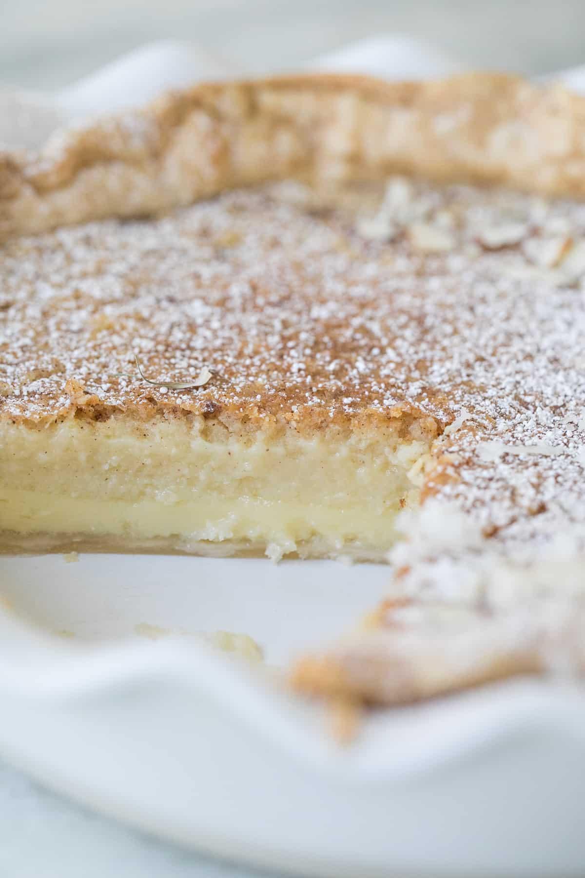 slice taken out of an egg custard pie
