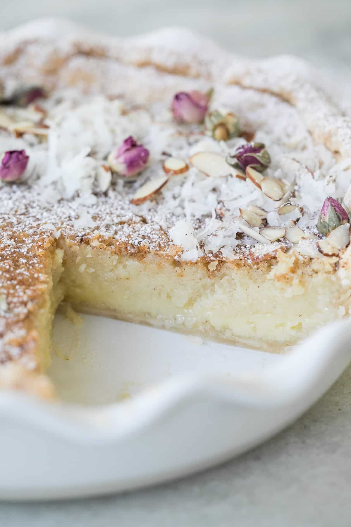 the best egg custard pie with a slice removed