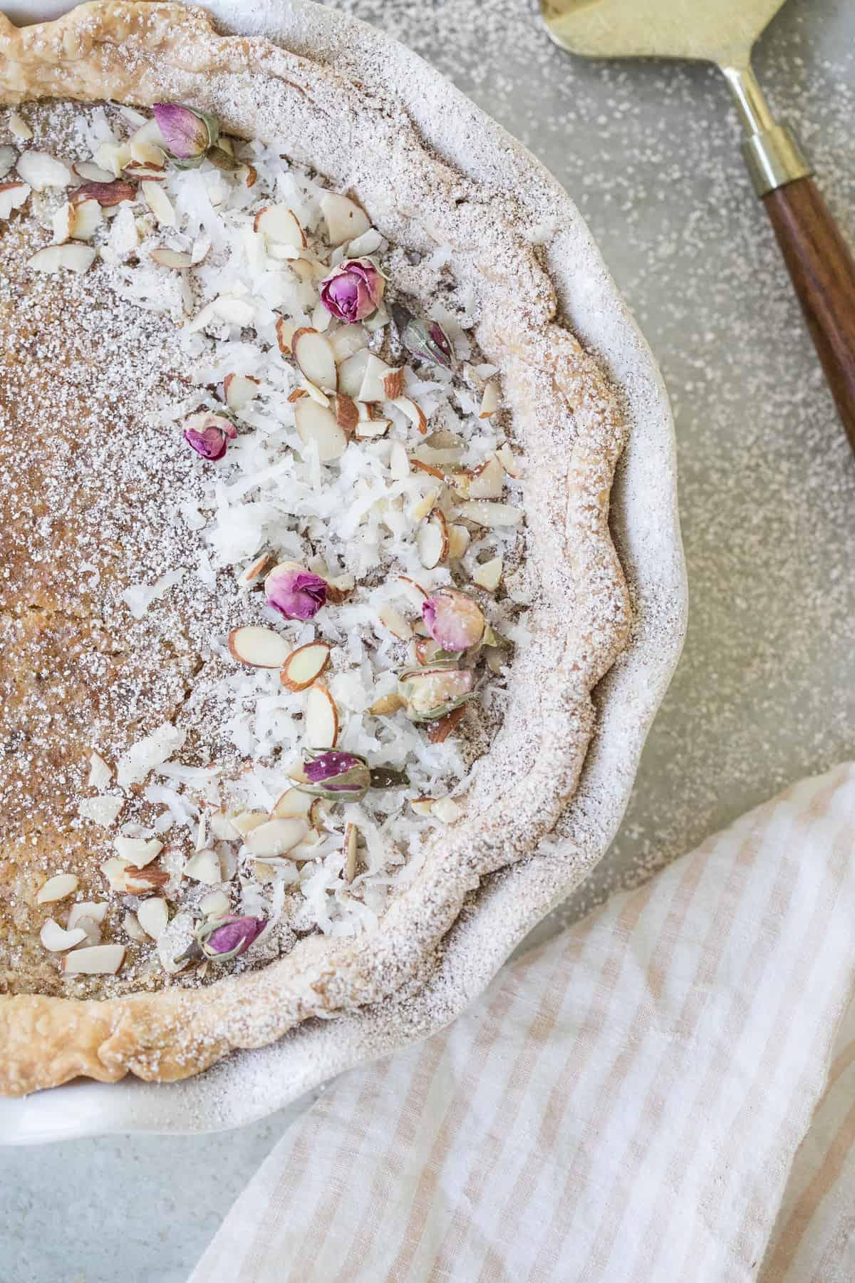 Egg custard pie with powdered sugar ad coconut