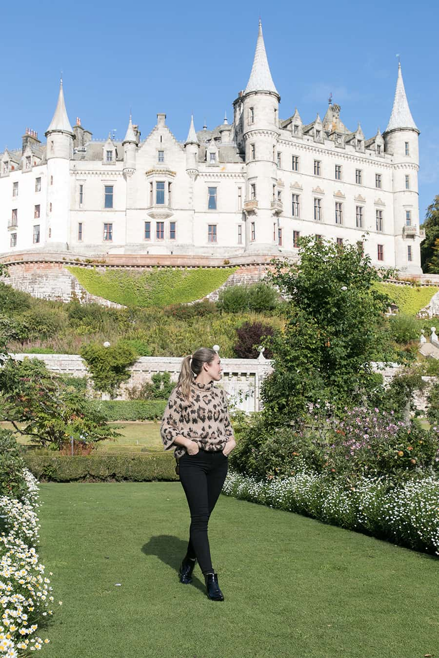 Eden Passante walking in front of Dunrobin Castle