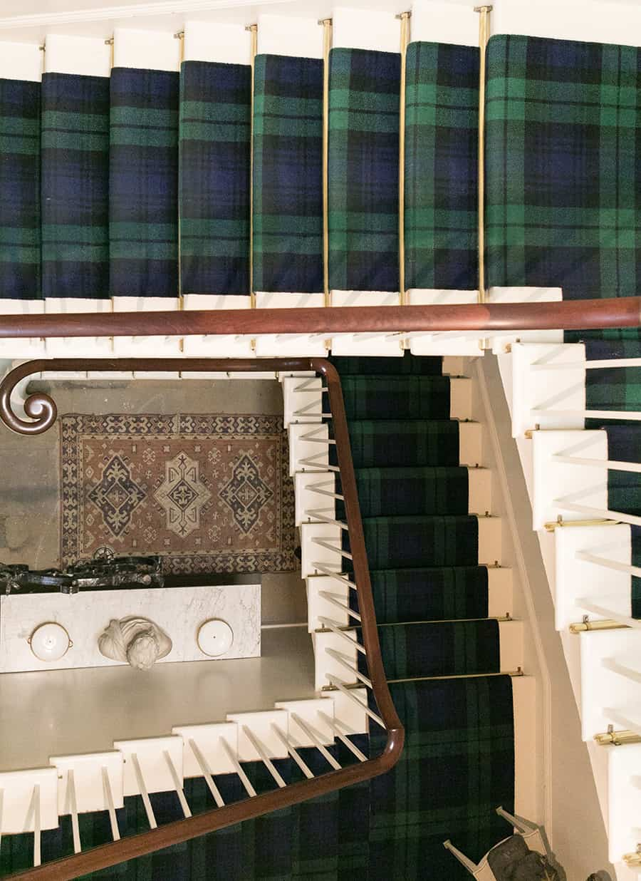 Stairs with plaid carpet at Dunrobin Castle