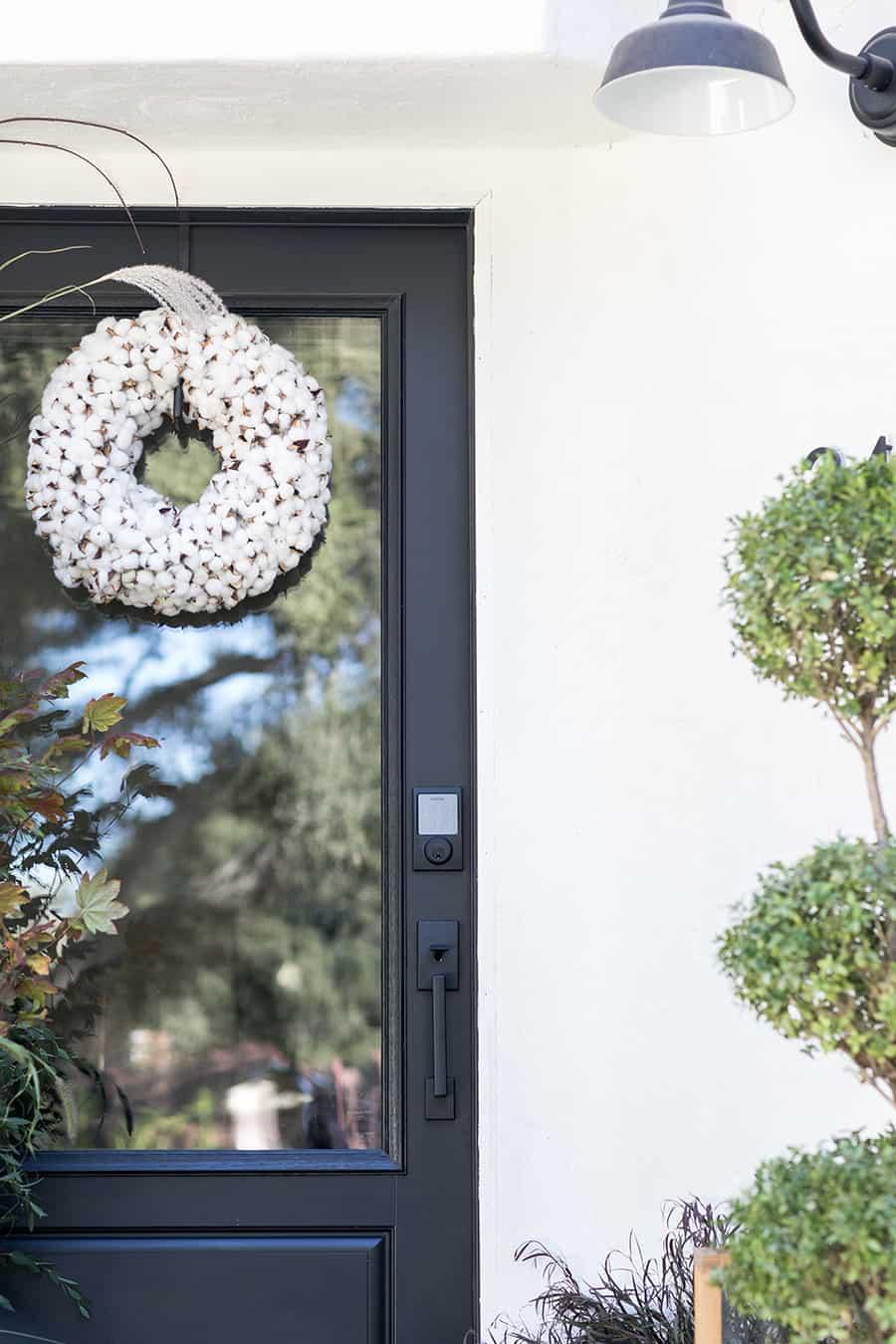 Black door with white wreath