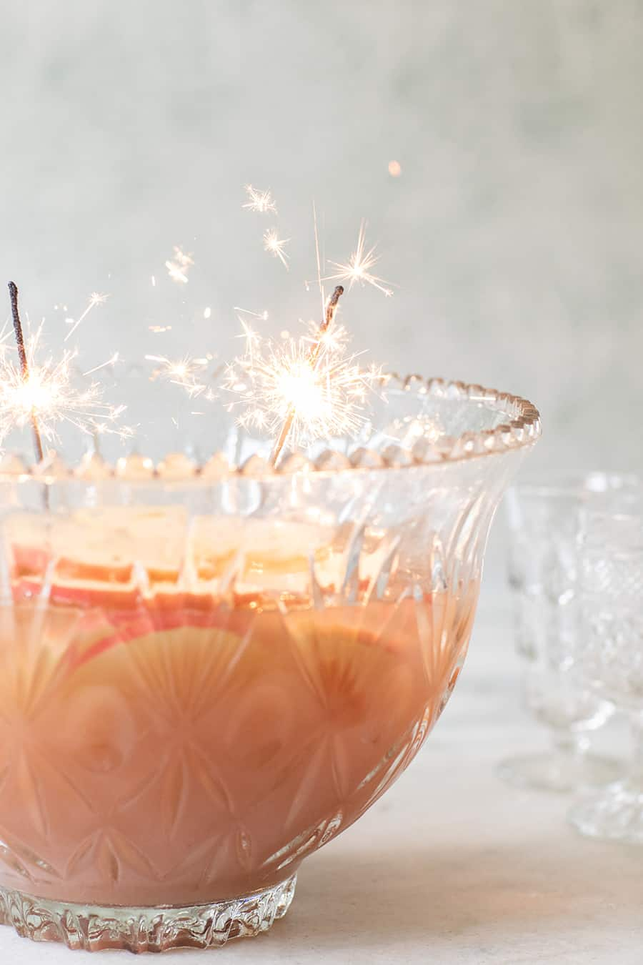 Holiday punch in a punch bowl with sparklers.