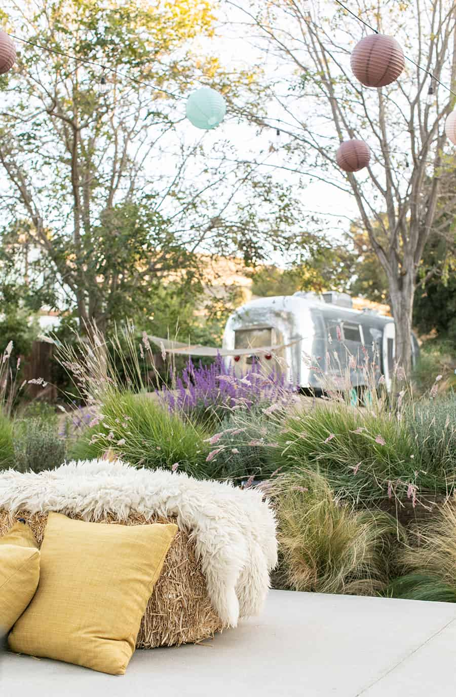 Hay bales with sheepskin, flowers and a vintage airstream.