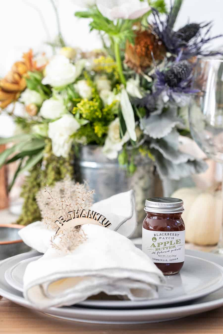 Be Thankful napkin rings and a jar of apple butter on a Thanksgiving tablescape