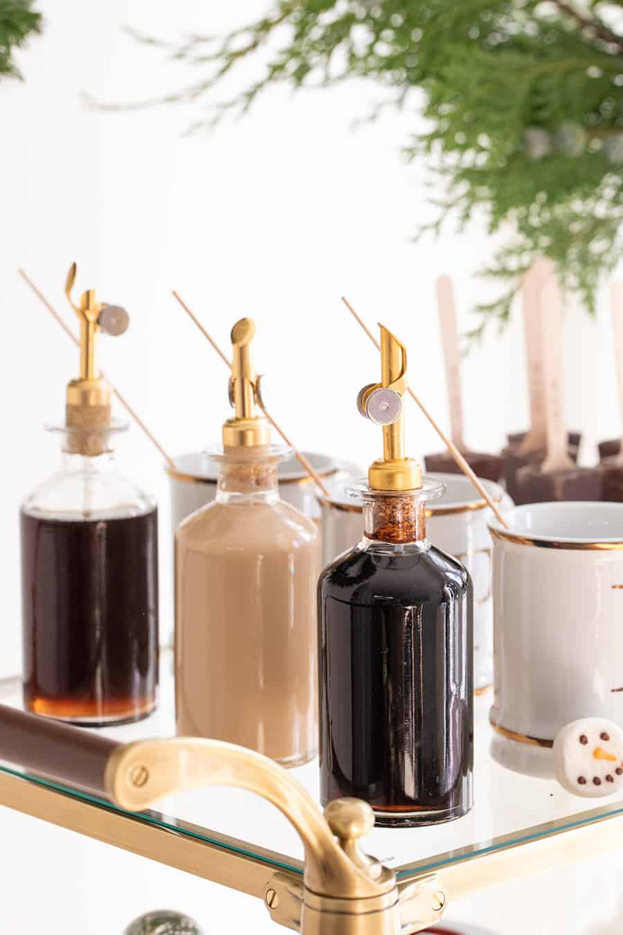 Syrups in glass jars with gold spout
