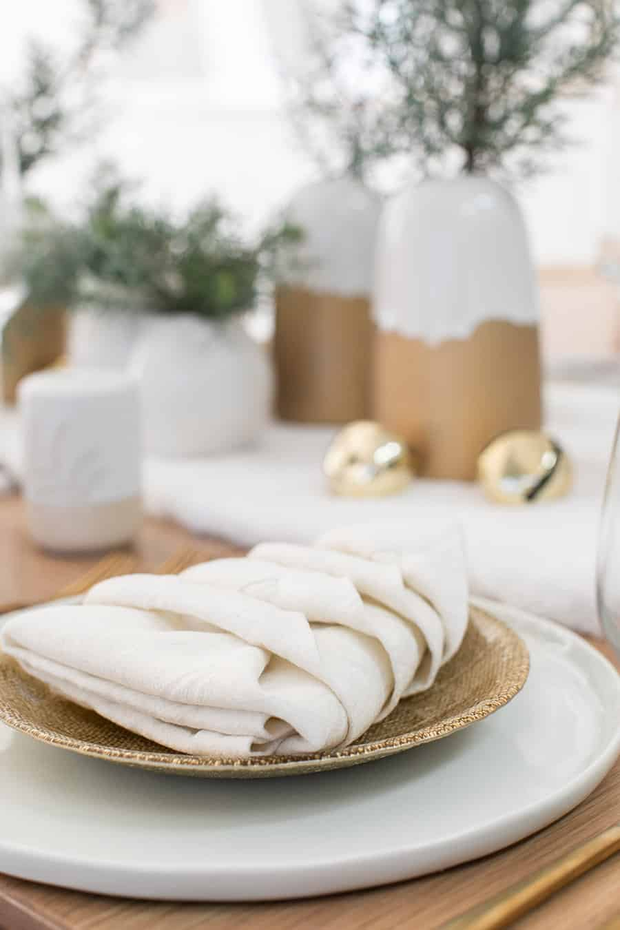 White napkin folded into a Christmas tree for a Christmas Brunch.
