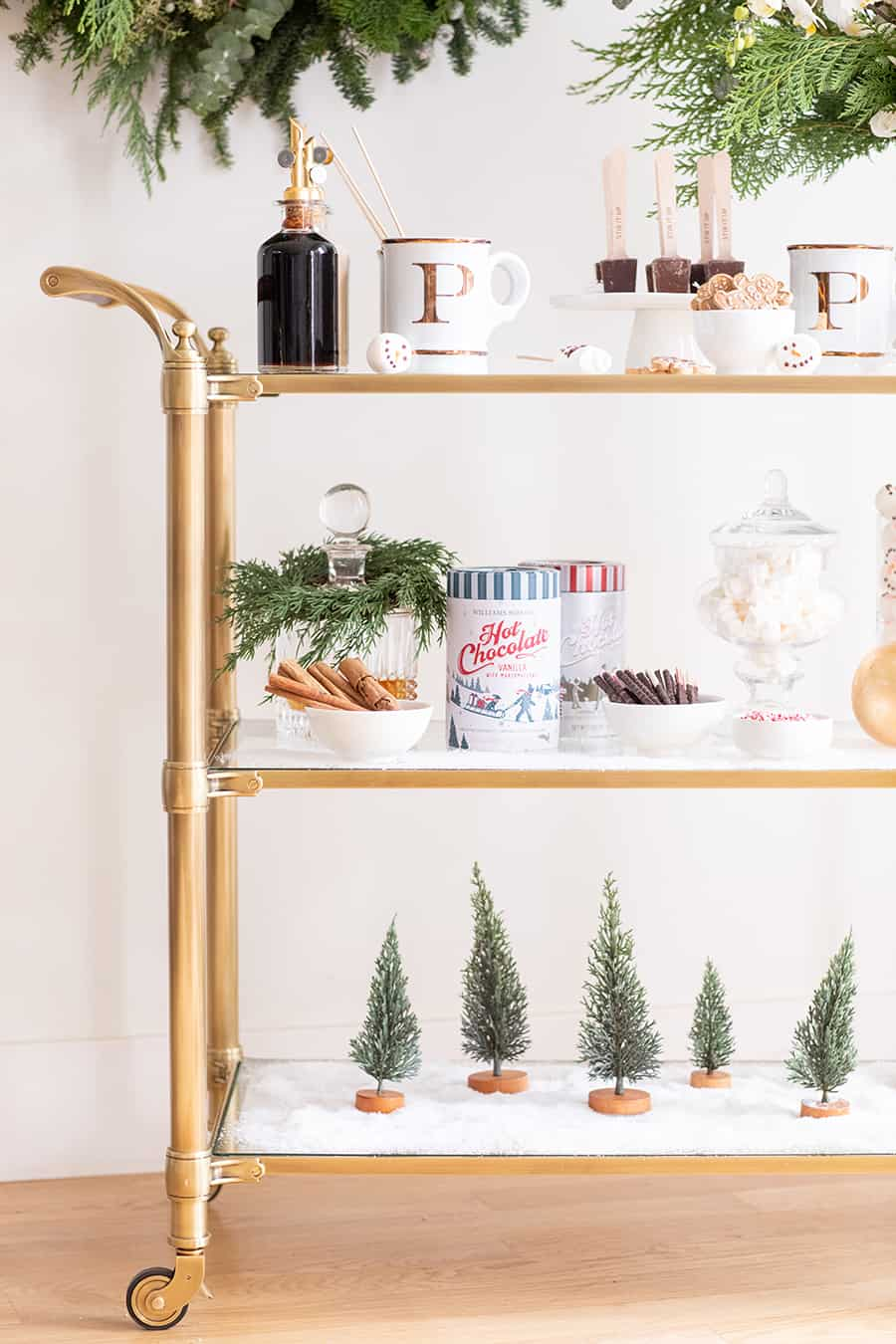 Bar cart with marshmallows, trees faux snow and mugs