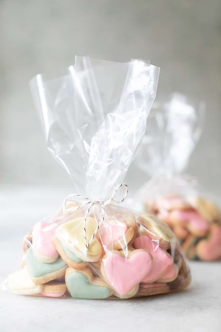 mini heart shaped sugar cookies in a plastic bag to give as a Valentine's Day gift