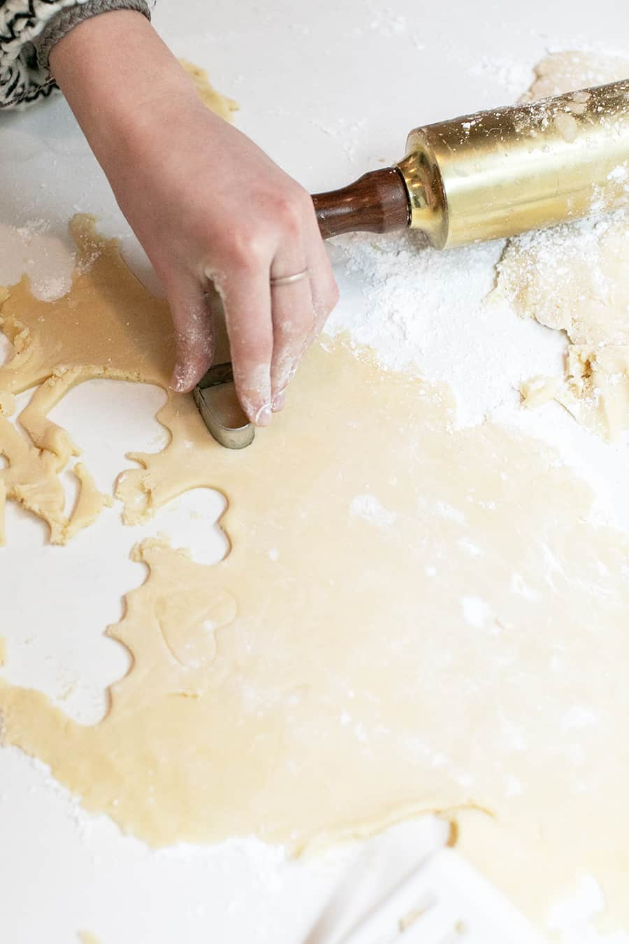 rolling dough for cut out heart shaped sugar cookies