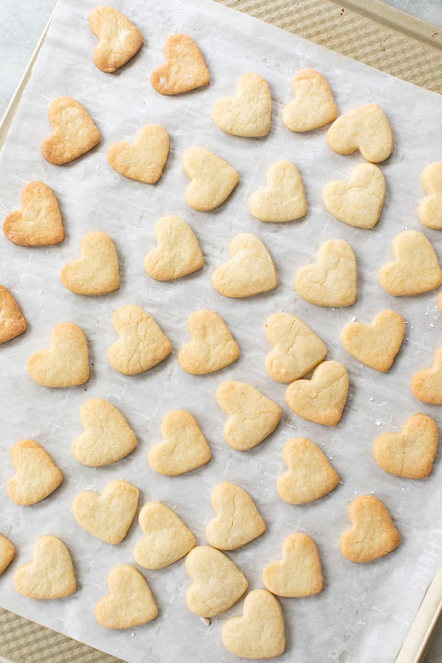 cut out heart shaped sugar cookies right out of the oven before frosted