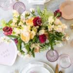 Valentine's Day Dinner Table Setting with Flowers and Pink Glasses