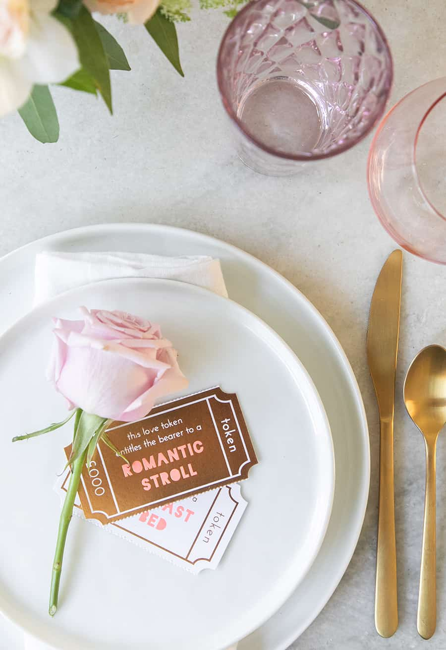 A single rose and token cards for a romantic Valentine's Day dinner.