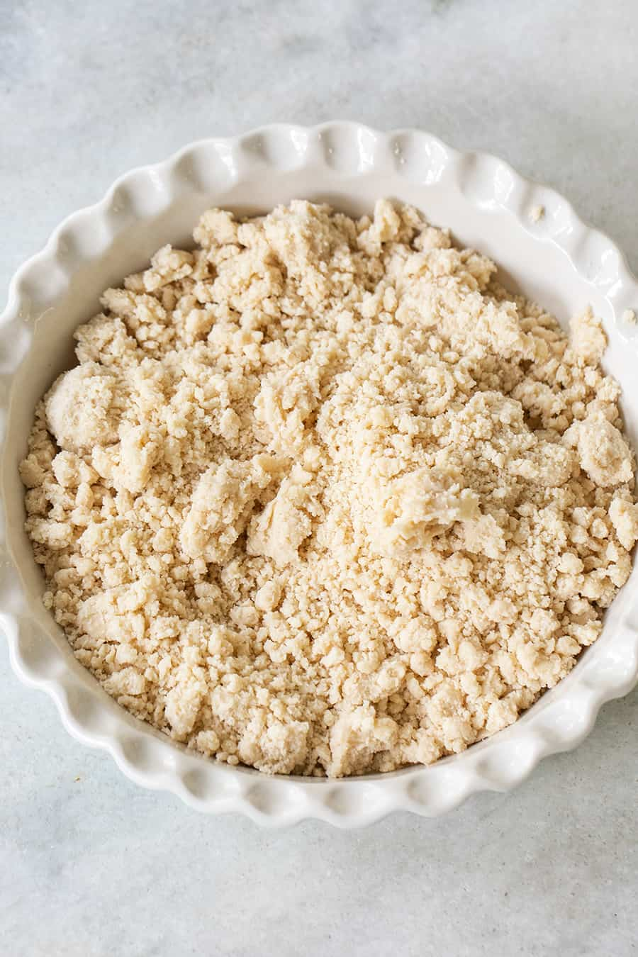 Cookie pie crust in a white pie dish.
