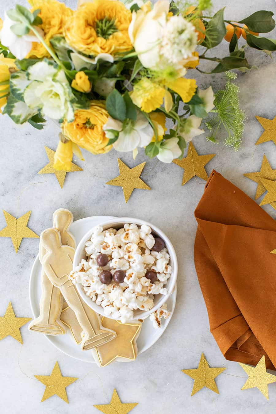 Popcorn and Oscar party cookies with gold stars.