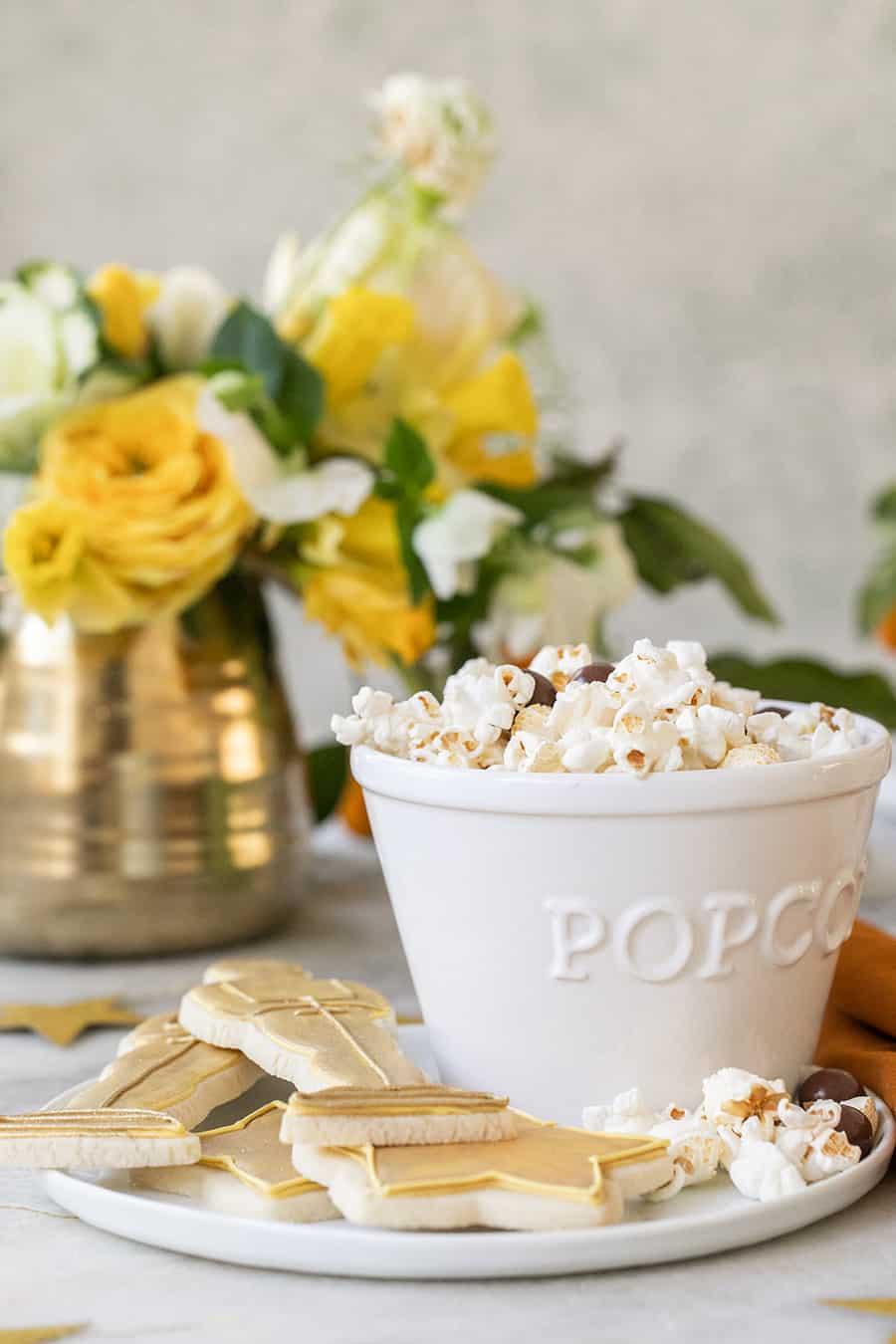 Popcorn in white popcorn bowl