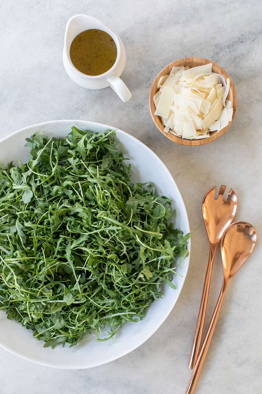 top down shot of ingredients, arugula and parmesan