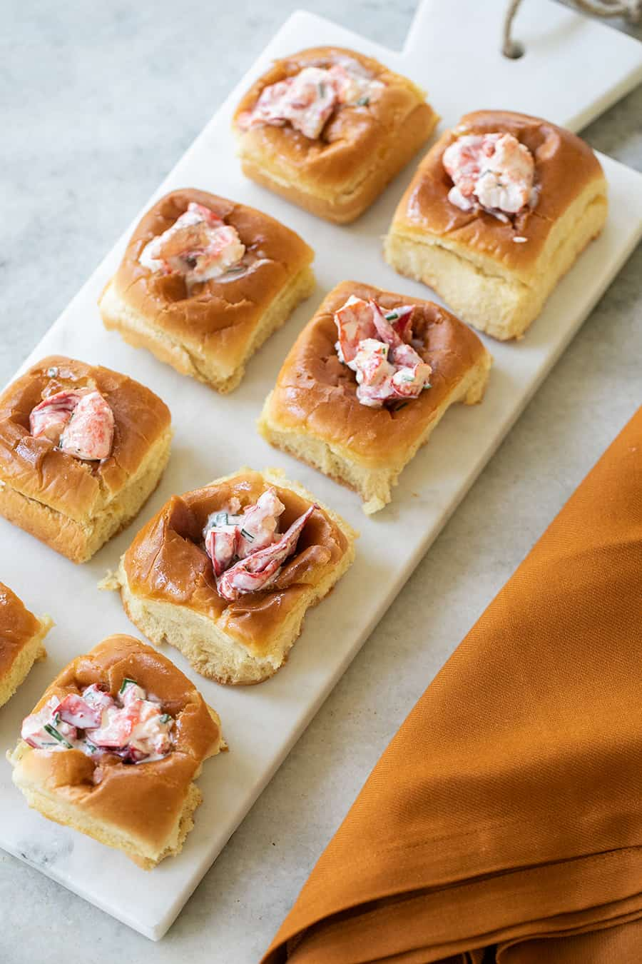 Mini lobster rolls on a marble tray